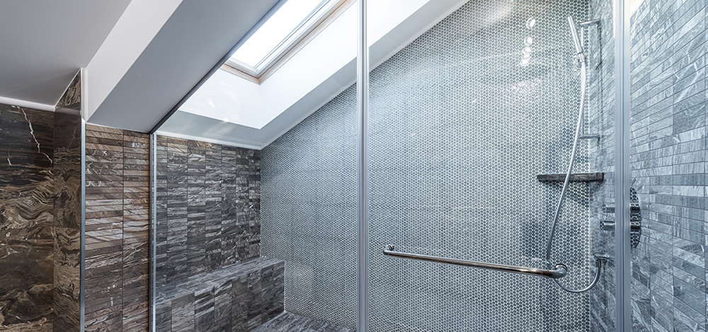 Glass shower cabin in modern loft bathroom
